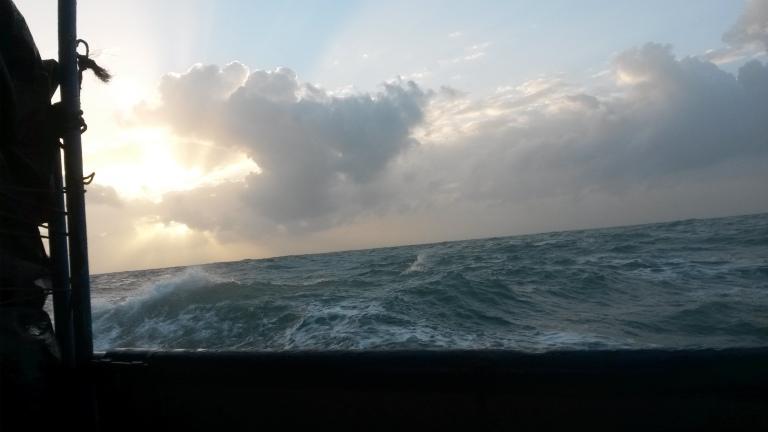 Sun rising over the Caribbean swells